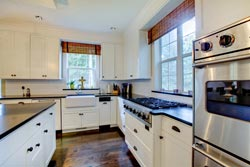 black granite white cabinets Granite kitchen - Orange County SUN CITY